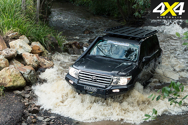 Custom LC200 driving through water