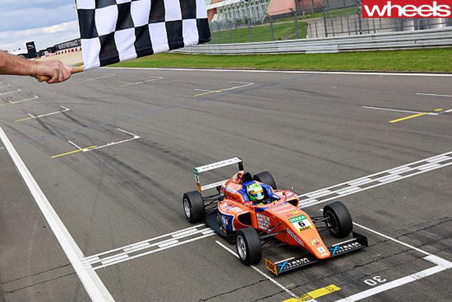 Australia -Formula -4-racing -car -passing -chequered -flag