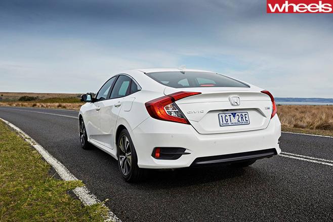 Honda -Civic -VTi -LX-rear -side -on -road