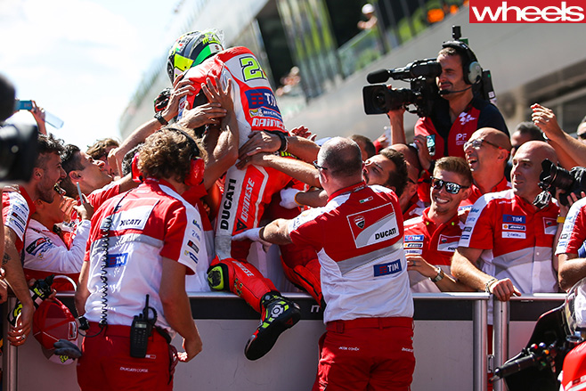 Andreas -Iannne -celebrates -in -crowd -2016-Austrian -Moto GP-track
