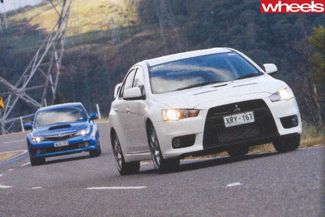 Mitsubishi -Lancer -Evolution -X-driving -with -Subaru -WRX-STi