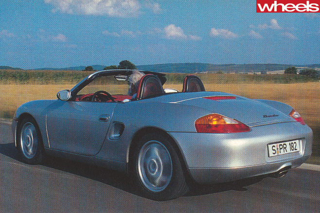 1996-Porsche -Boxster -986-driving -top -rear