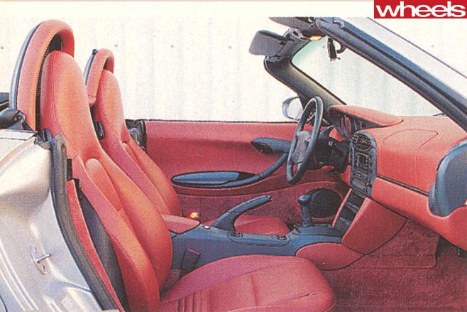 1996-Porsche -Boxster -986-drivingtop --rear