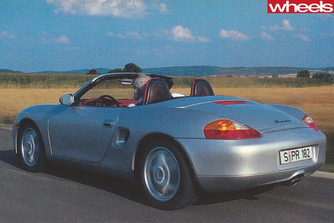 1996-Porsche -Boxster -986-driving -top -rear