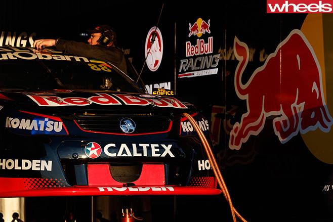 Red -Bull -HRT-car -in -garage
