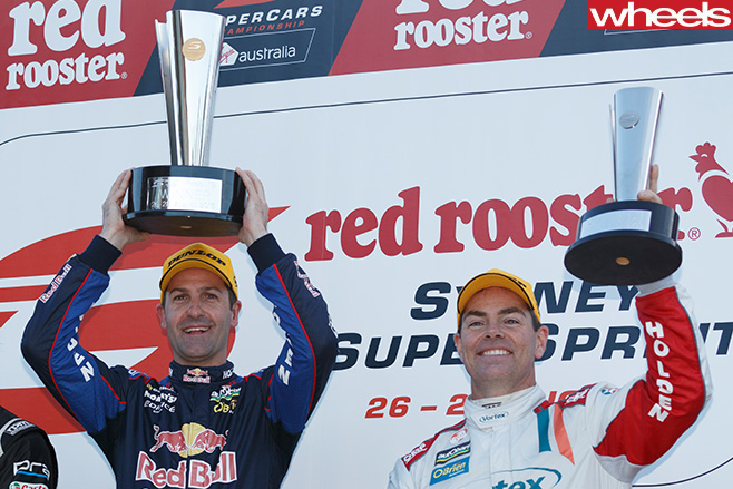 Craig -Lowndes -holding -trophy