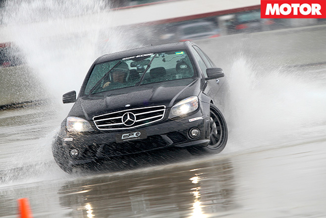 Black merc driving hard