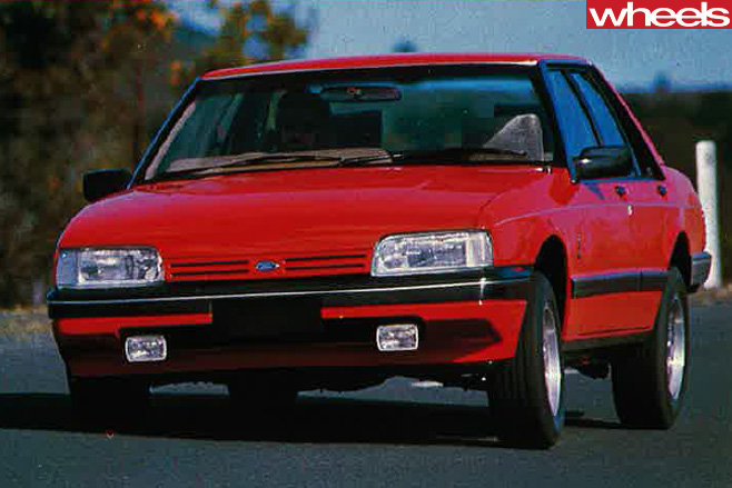 1984-Ford -Falcon -Ghia -driving -front -side