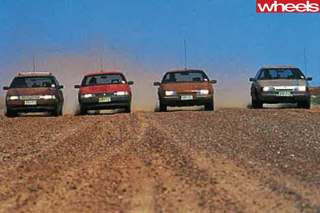 1988-Ford -Falcon -EA-26-vs -Holden -Commodore -VN-driving -sand