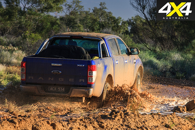 Ford ranger driving mud rear view