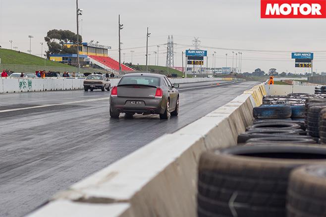Chrysler 300 SRT driving down the drag strip