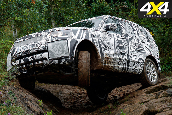 Fifth-gen Land Rover Discovery driving forest