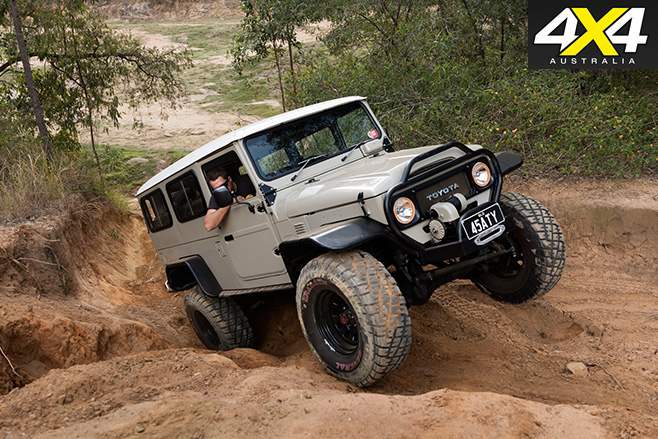Custom Toyota FJ45 Troop Carrier driving uphill