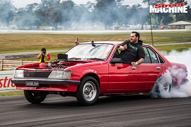 Performance car mania red holden VH commodore burnout