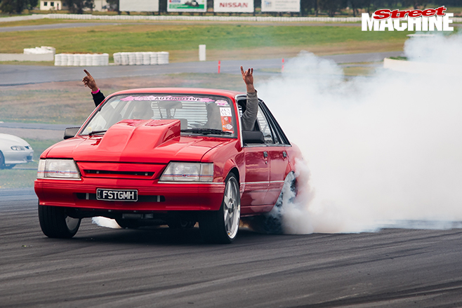 Performance car mania red holden vk commodore burnout