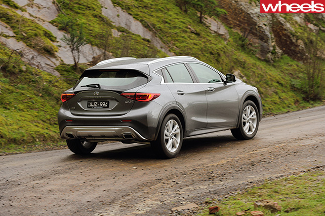 Infiniti -Q30-driving -rear -side