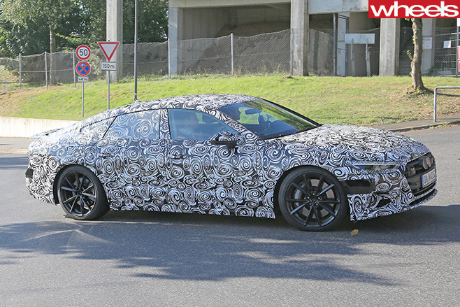 Audi -S7-spy -pic -driving -side -on