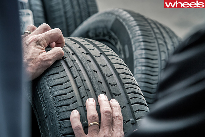 Checking -tread -on -worn -tyre