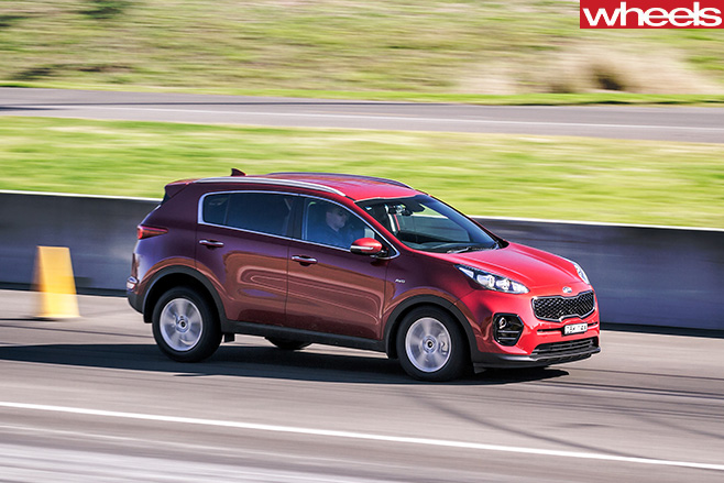 Kia -Sportage -driving -front -side
