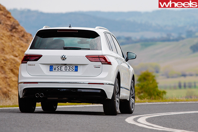 Volkswagen -Tiguan -R-Line -driving -rear -side