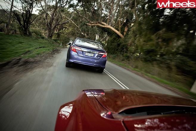 2012-Toyota -Camry -Hybrid -driving -rear -Australian -car
