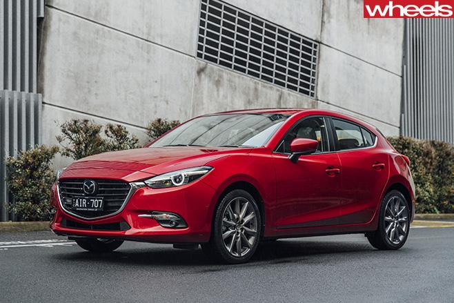 Mazda -3-side