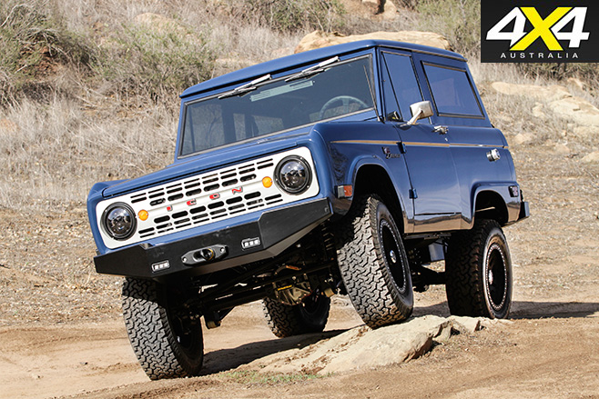 Ford Icon Bronco driving over rocks
