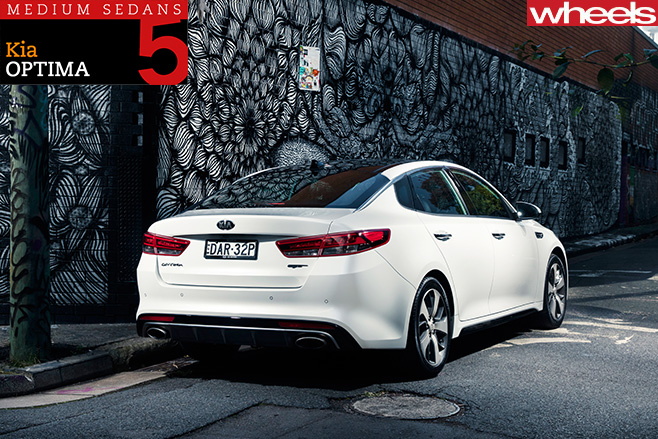 2016-Kia -Optima -driving -rear -side