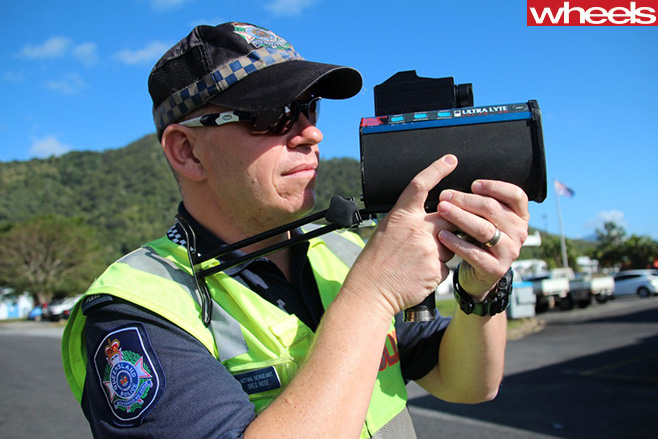 Police -officer -with -speed -camera