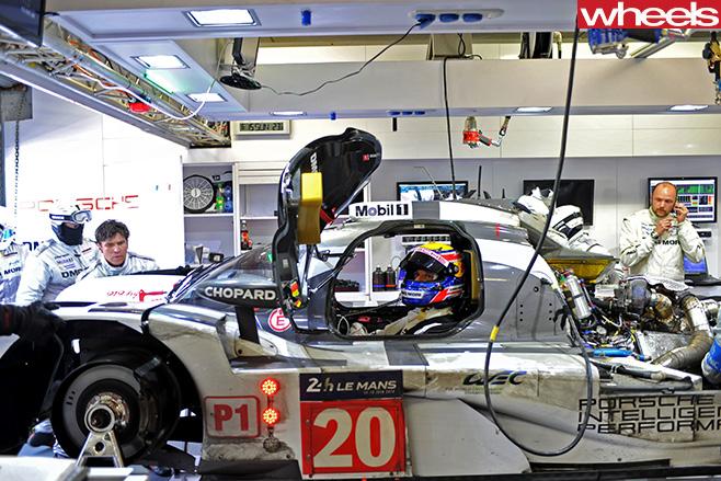 Porsche -team -in -garage