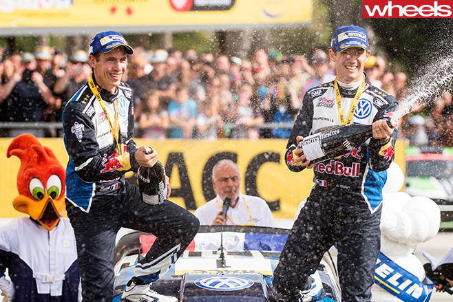 Sebastian -Ogier -celebrates -win -WRC-Spain -spraying -champagen
