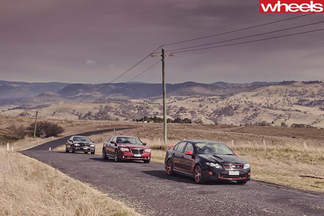 2012-FPV-GT-R-Spec -vs -Chrysler -300-SRT8-vs -HSV-Clubsport -R8-driving -front -side