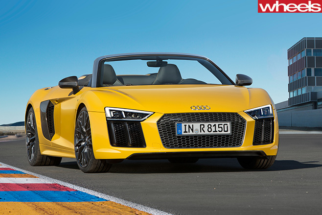 Audi -R8-spyder -driving -front -parked -track