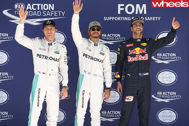 Daniel -Ricciardo -Lewis -Hamilton -standing -on -F1-podium