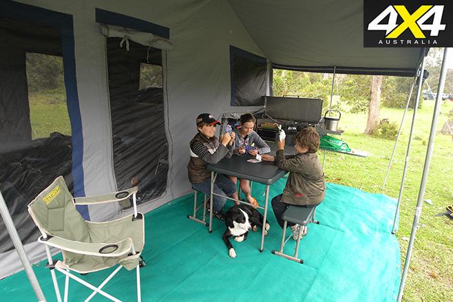 Kids sitting under tent