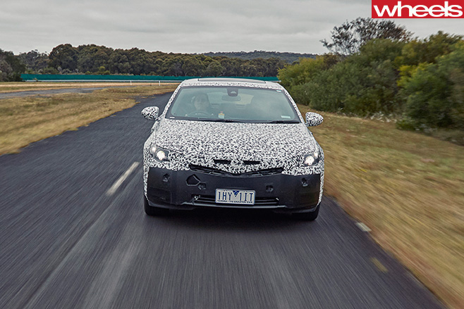 2018-Holden -Commodore -sand -driving -front