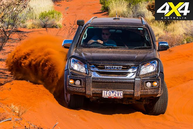 Isuzu MU-X driving sand