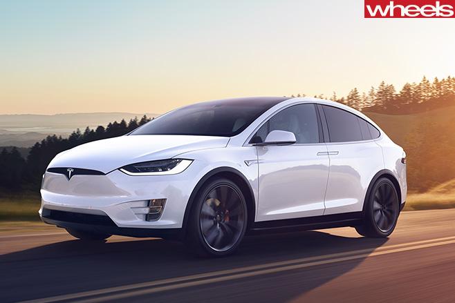 Tesla -Model -X-driving -sunset