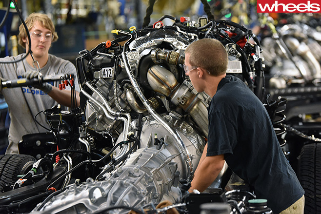 Ford -factory -worker -assembles -Ford -engine