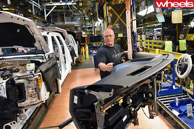 Ford -factory -worker -assembles -Ford -F150-rouge -truck