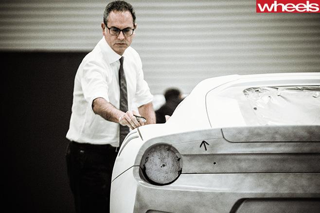 Flavio -Manzoni -looking -at -Ferrari -body -work