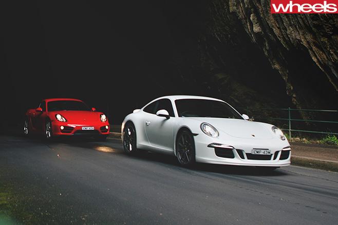 Porsche -Cayman -vs -Porsche -911-Carrera -S-driving -front