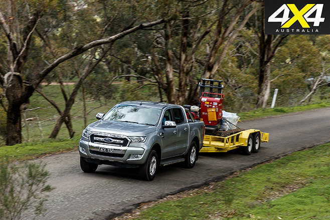 Ford Ranger driving with trailer on road