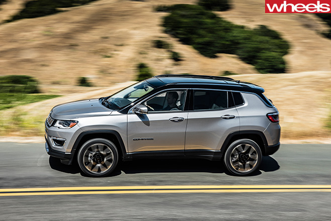 2017-Jeep -Compass -driving -side