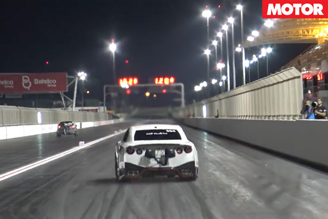 Nissan GT-R racing down drag strip