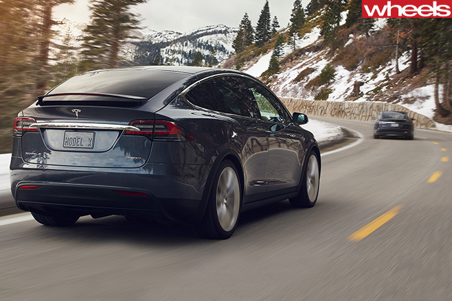 Tesla -Model -X-driving -rear -mountain -pass