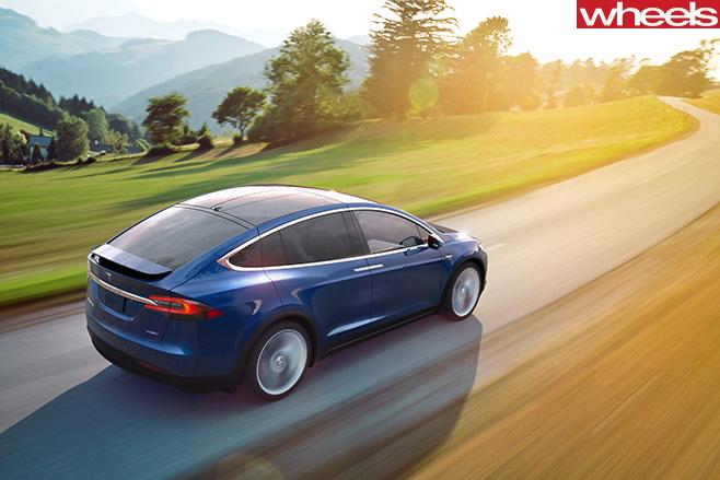 Tesla -Model -X-driving -rear