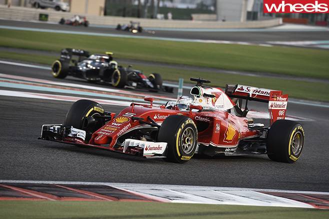 F1-Ferrari -race -car -driving -track