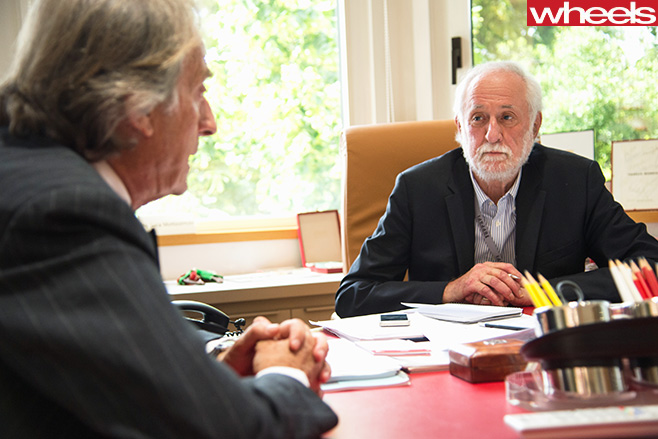 Peter -Robinson -talking -to -Ferrari -executive -in -Maranello