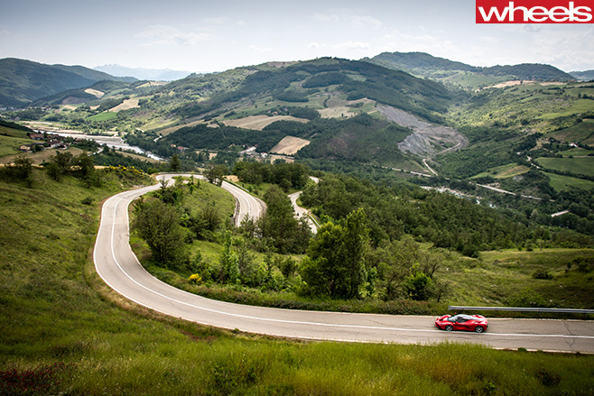 Ferrari -Enzo -driving -down -mountain -pass